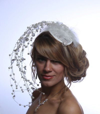 Ivory teardrop fascinator hat with wired pearls and marabo feathers (1)