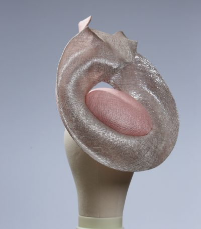 Pale dusky pink button pillbox hat with a silver shimmery lurex saucer